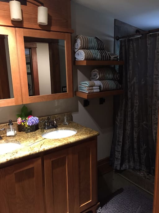 Downstairs suite's dedicated bathroom with double sinks and walk in shower.