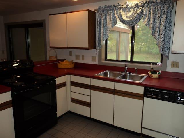 Fully stocked kitchen with dishwasher.