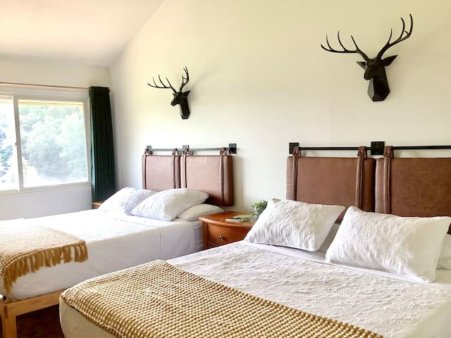 Settle down in the modern-rustic master suite with two balconies, two queen beds, en suite master bathroom, and Mountain Views as you relax in bed!