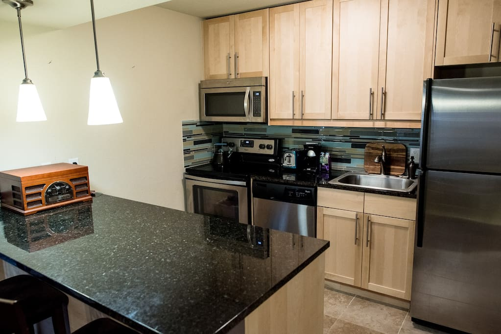 This is your fully-equipped kitchen with all utensils, dishwasher, microwave, oven, etc.