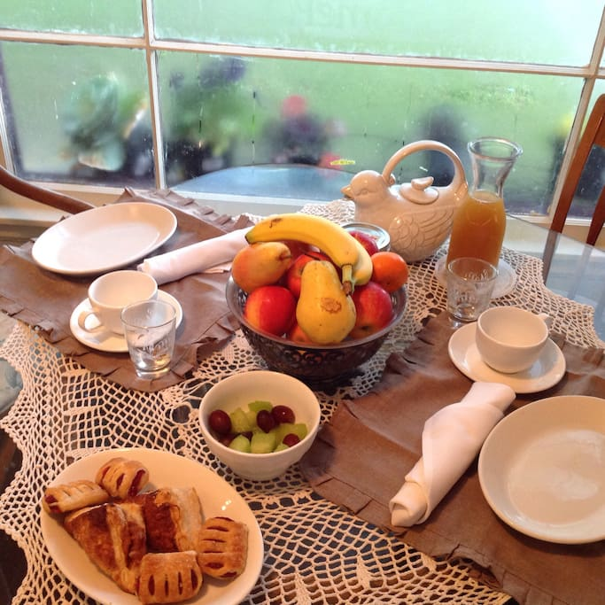 Breakfast in front of pretty window. Fresh pastries, premium coffee, or tea. Breakfast often cooked to order for BnB guests. Interns and extended stay guests are supplied with fresh fruit, bagels, cereal, oatmeal, eggs, juice weekly to prepare their own breakfast...and load the dishwasher when finished please!