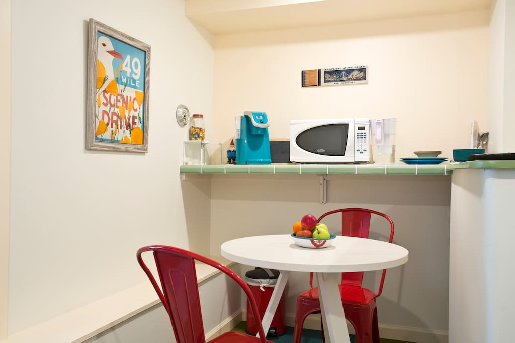 Cozy eating nook equipped with microwave and coffee maker