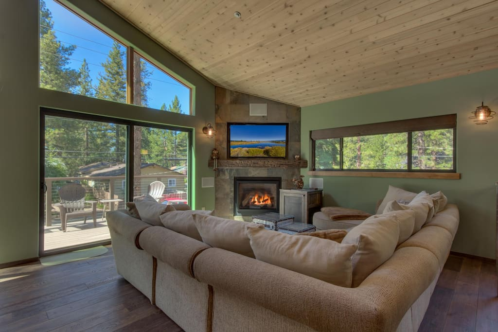 Open living room HD TV above gas fireplace