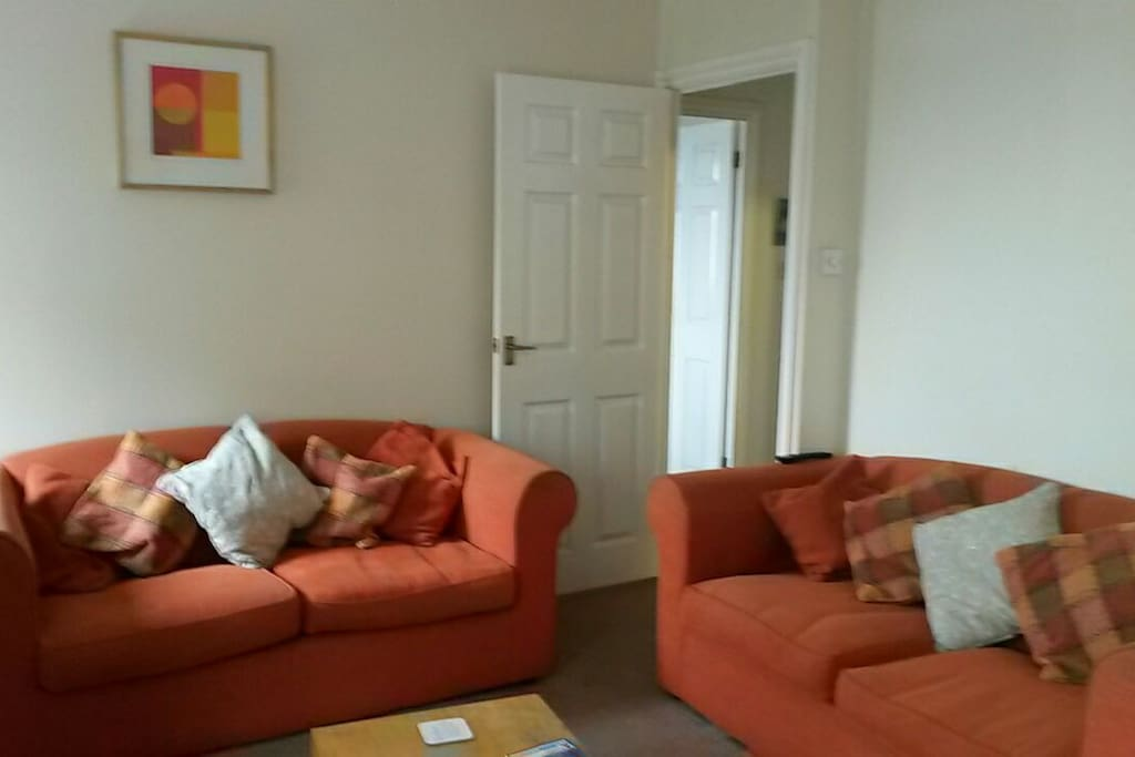 Very large, sunny living room with two sofas overlooking Twickenham Stadium