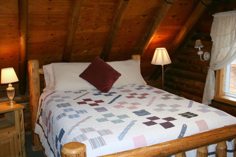 Queen log bed.