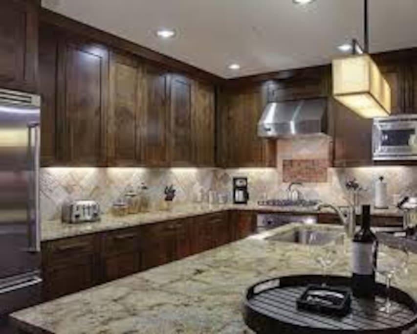 Fully stocked gourmet kitchen with Viking appliances