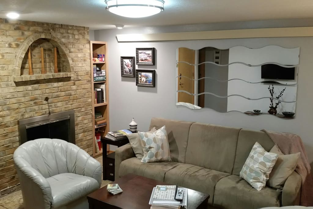 A gas fireplace to keep you warm and cozy! We've recently upgraded the fold-out sofa in the living area to the one pictured here.