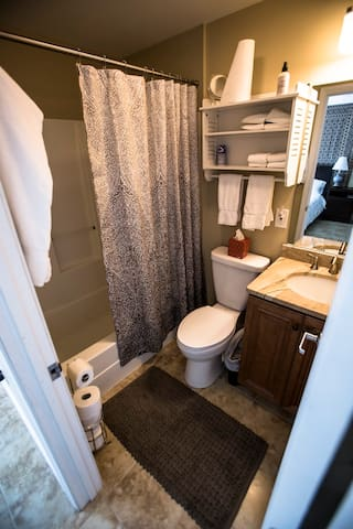 Full private bathroom with fresh towels and bathrobes
