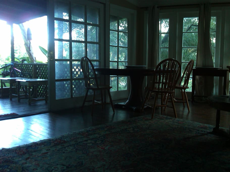 dining area with natural sunlight through main entrance