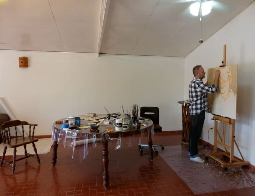 If you are coming for an art retreat, there is a 10 feet studio wall and easel