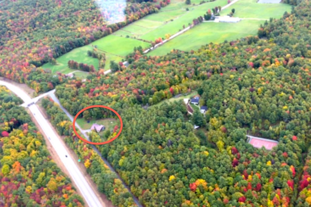 Areal view of house.  Surrounded by well over 100 acres of protected land and beautiful hiking trails. The fields at the top of the photo is Ramblin' Vewe Sheep Farm, just a quarter mile down the road.