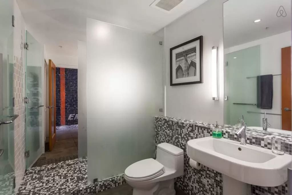 The two restrooms are separated by a shared shower