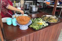 """Thai authentic delicious dish of """"Nam-Prik-Pla-Too"""". A rice dish with tasty spicy sauce, top with veggy and deep fried fish. Available close to our condo :)"""