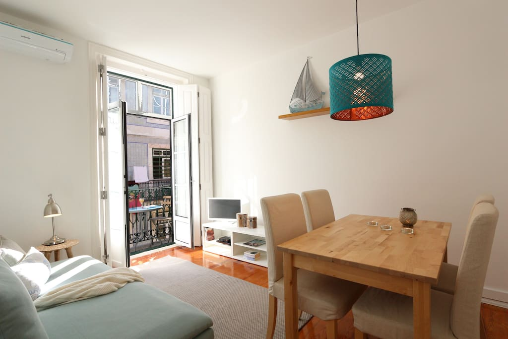Comfortable dinning space in the living room with AC and wifi