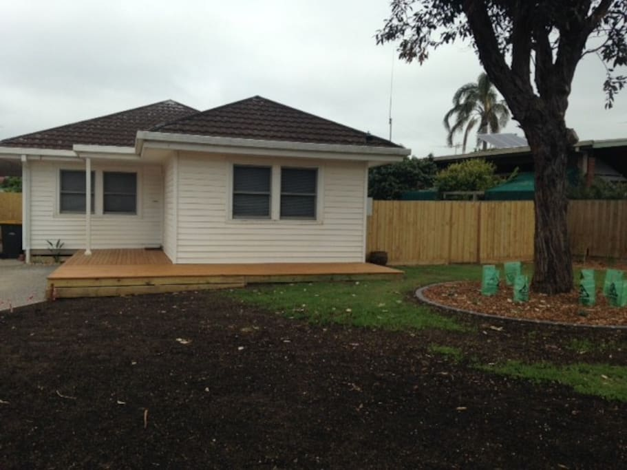 House and front garden...newly landscaped with deck (excuse the growing lawn)