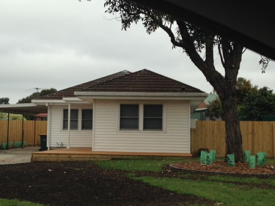 Front of the house with car port for 1 car
