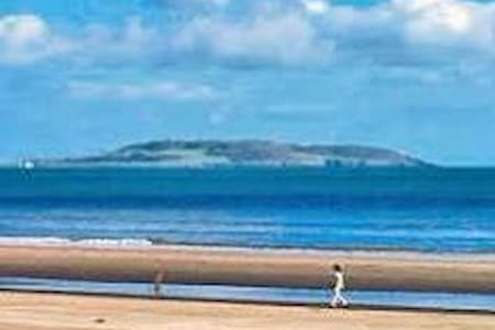 Double bedroom in a two bed apartment lived in by the owner, who has travelled the globe over the years.  Portmarnock has a beautiful beach and is well connected to the city by the train service 5 minutes away.