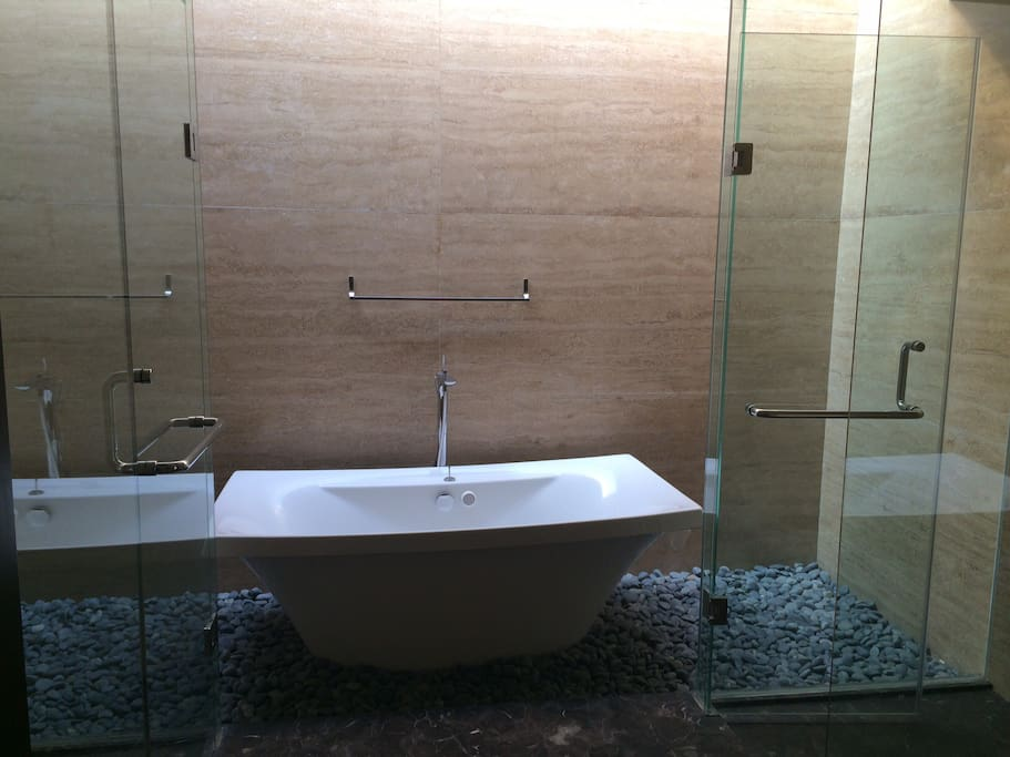 Huge bathroom with bathtub and shower