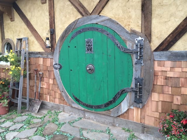 The classic green door symbolizes tranquility & harmony to all who enter.
