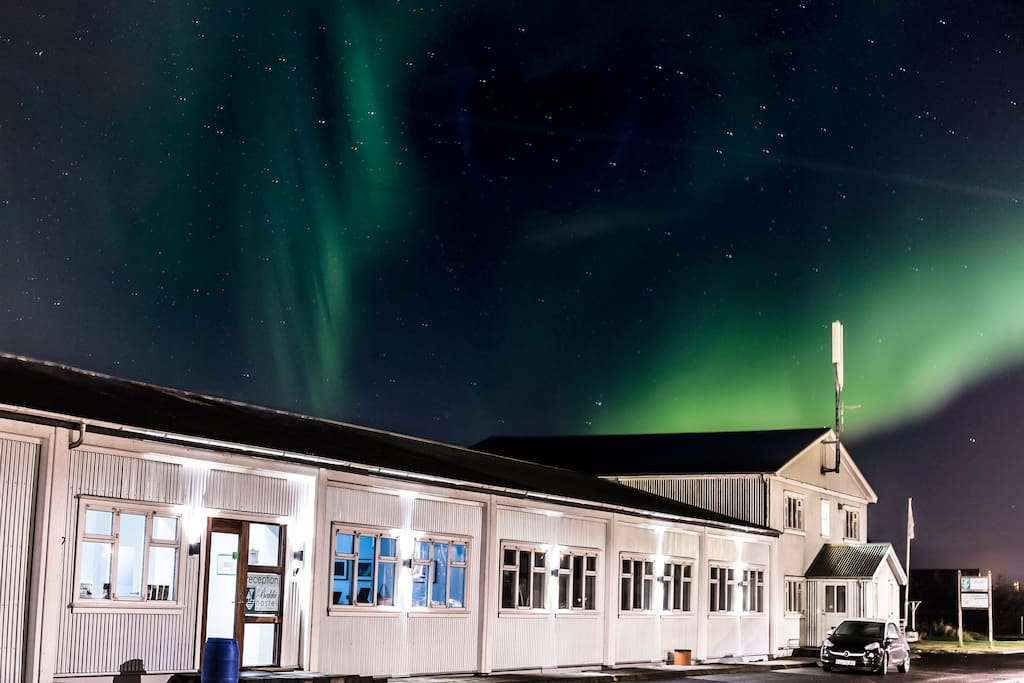 Northern lights overhead! The apartment is in the two-story section of this building, on the far right.