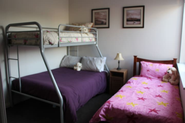 Third bedroom has double bed and 2 singles
