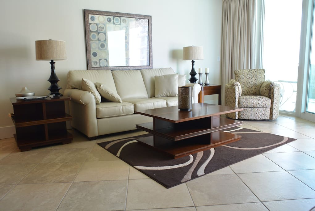 Living Room with Leather Queen Size Sofa Bed and Swivel Recliner