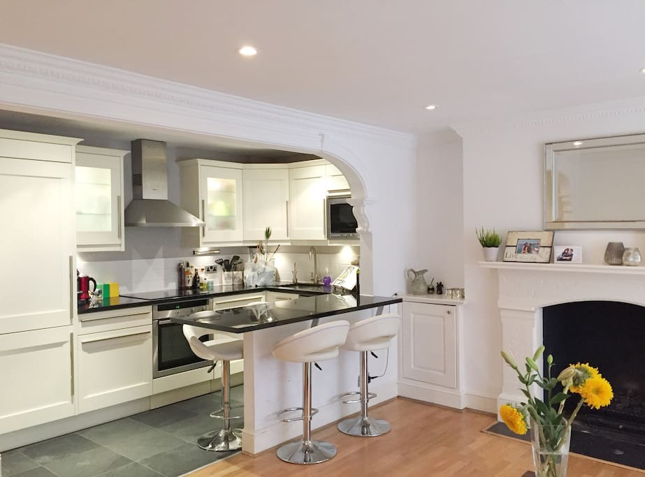 The spacious and recently refurbished living room, with modern open plan kitchen