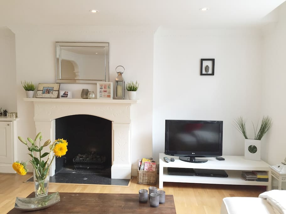 The spacious and recently refurbished living room, with working fireplace