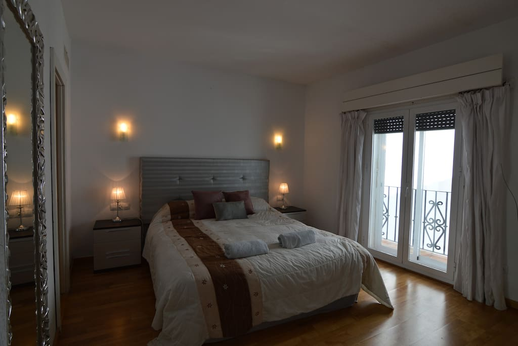 Master bedroom with ensuite bathroom and views
