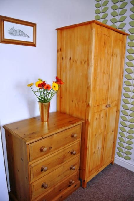Double room with real bed, wardrobe and chest of drawers.