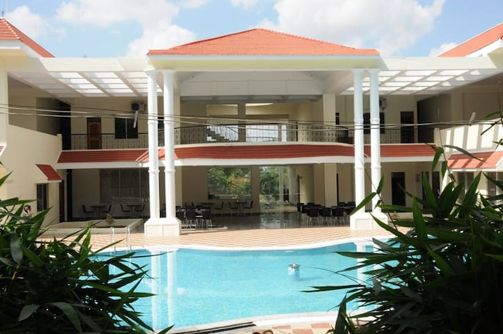 Golden Mile Resort with swimming pool and greenery