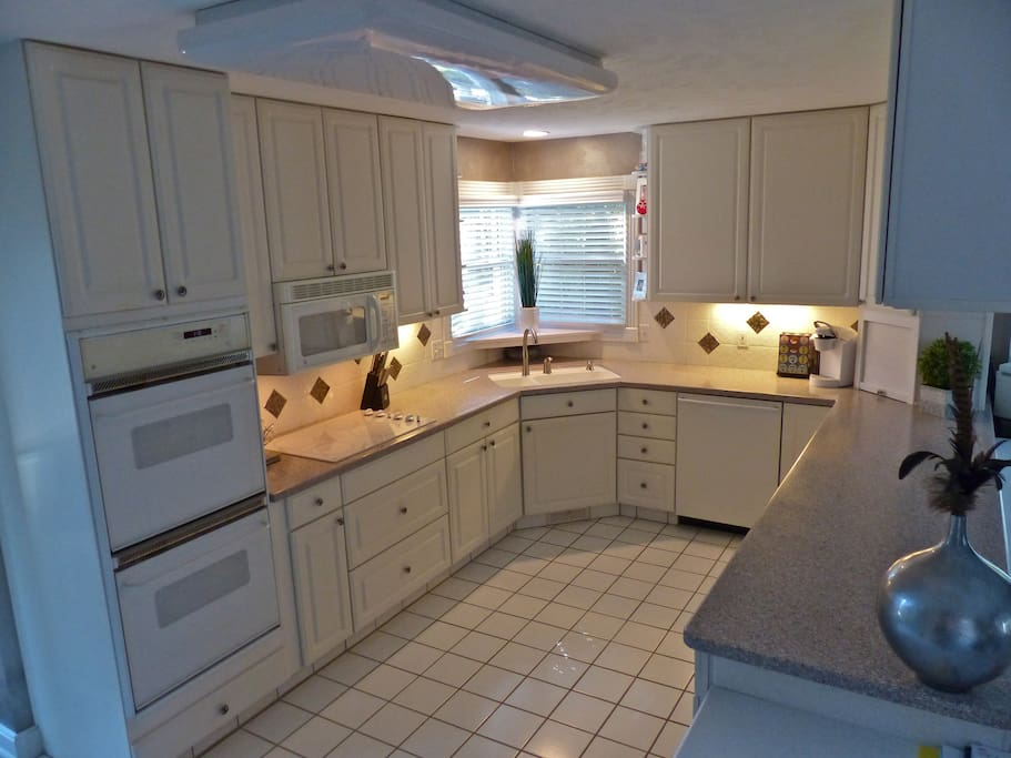 Kitchen w/ double oven, Microwave, trash compactor, Dishwasher and full cooking & serving utensils.  Kehrig coffee maker.