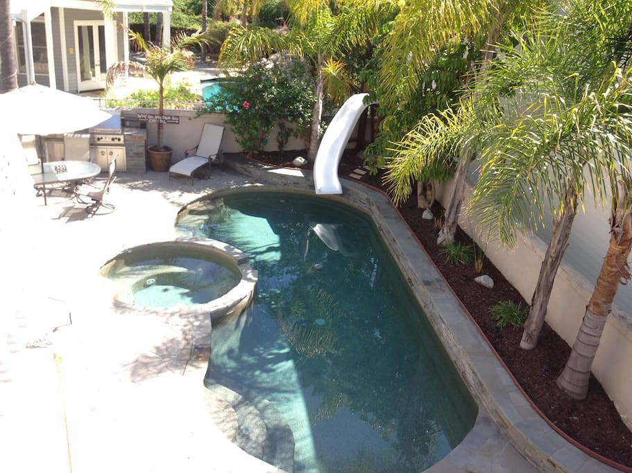 Backyard is perfect for entertaining. Has seating and BBQ.