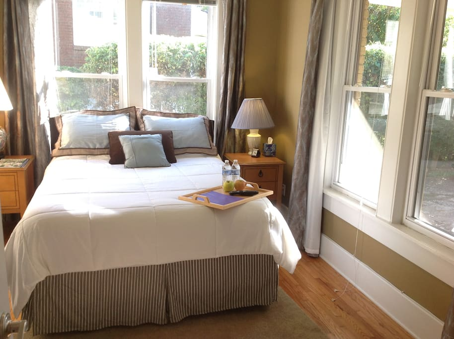 Comfortable, private queen size bedroom in sunny room, but with blinds and curtains for privacy and good sleeping.
