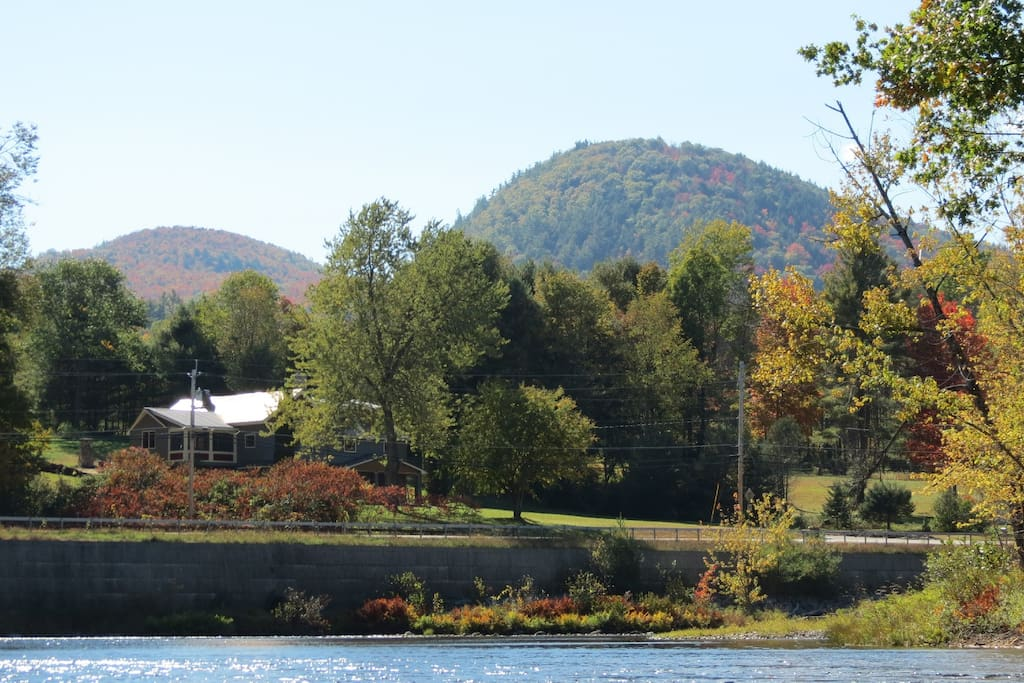 View of Stone Schoolhouse and Pine Mountain from Schroon River.
