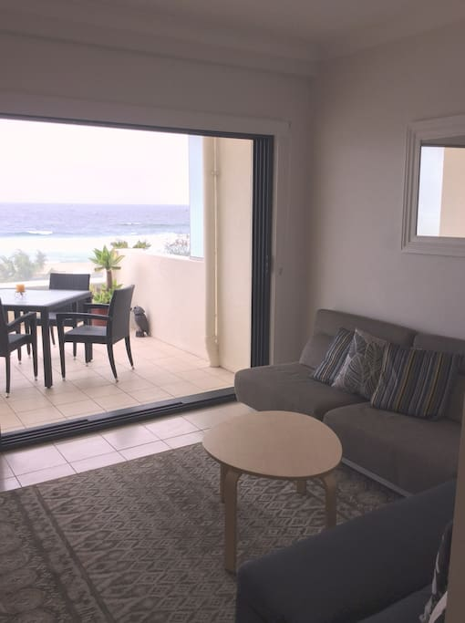 The lounge flows out onto the terrace or sit inside and watch the view on a rainy day.