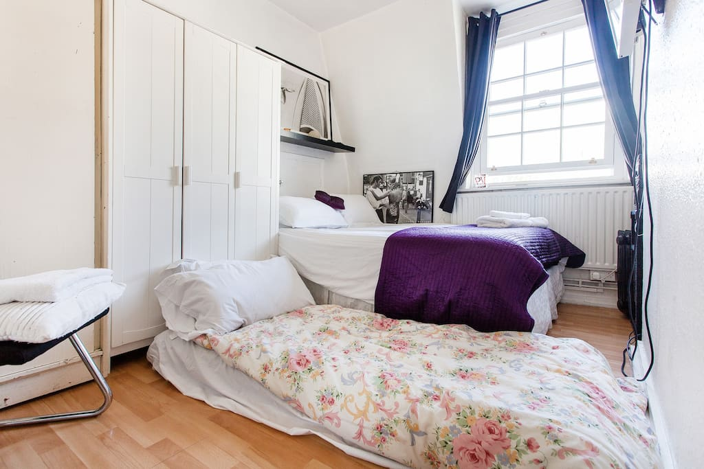 Bedroom with double bed and an inflatable single bed to accomodate up to three guests
