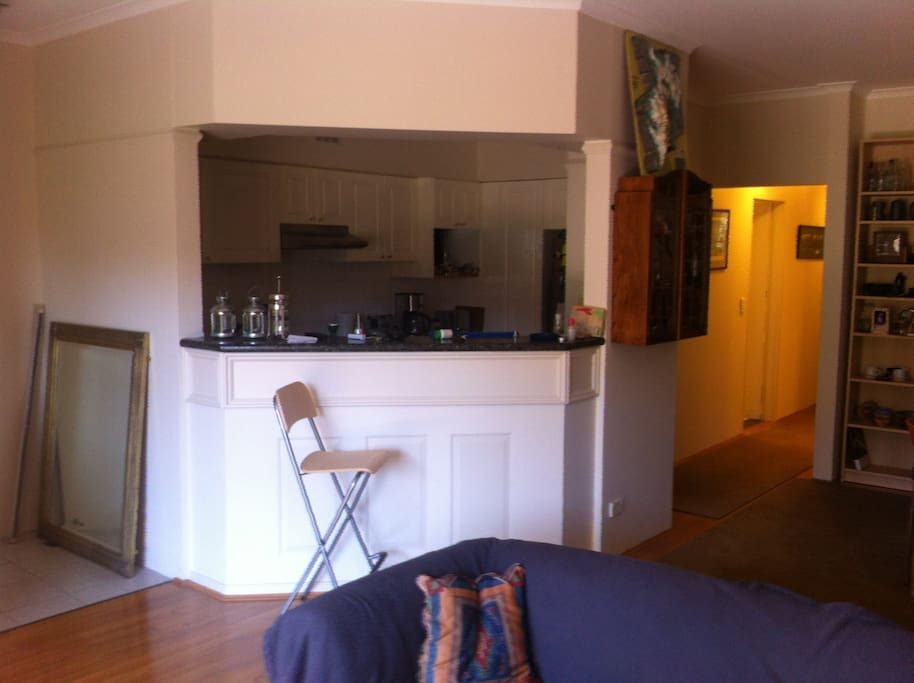 Bar kitchen with electric stove, cooktop, dishwasher