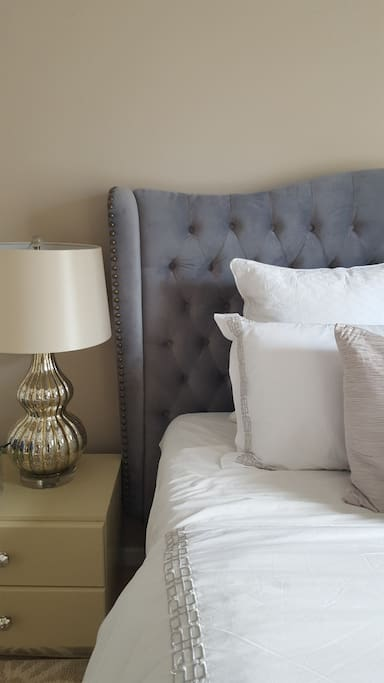 Beautiful queen sized bed with luxury linens