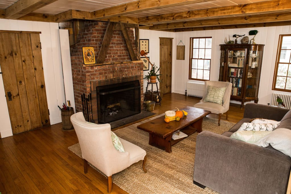 LIVING AREA (1st Floor): Renovated to showcase the original brick fireplace, there's a barrel of marshmallow skewers for after dinner s'mores.