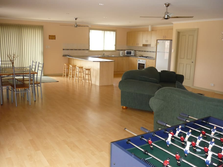 Open plan living area with game