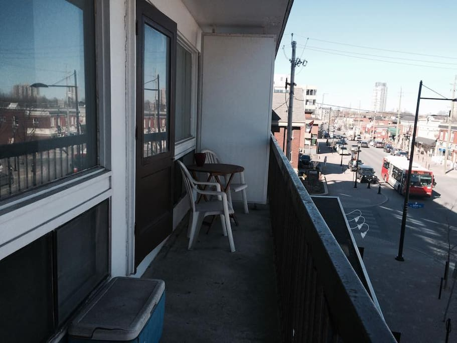 Balcony with small charcoal BBQ and long enough to store a bike, with a great view of Wellington St. West