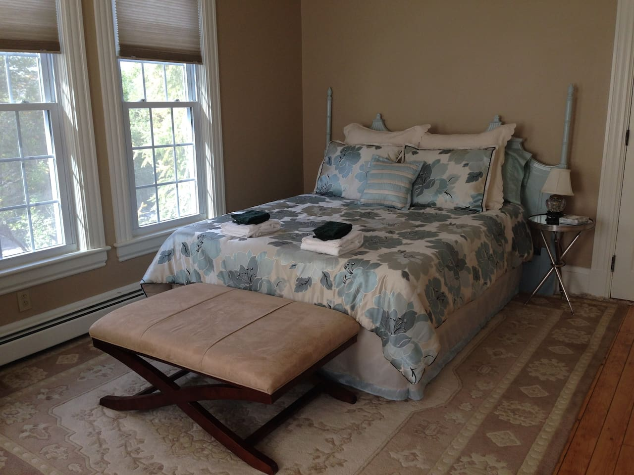 Our largest guest room, the Turret Room features a by window, Tempur-Pedic queen with featherbed topper, leather recliner, oriental rugs, Asian decor