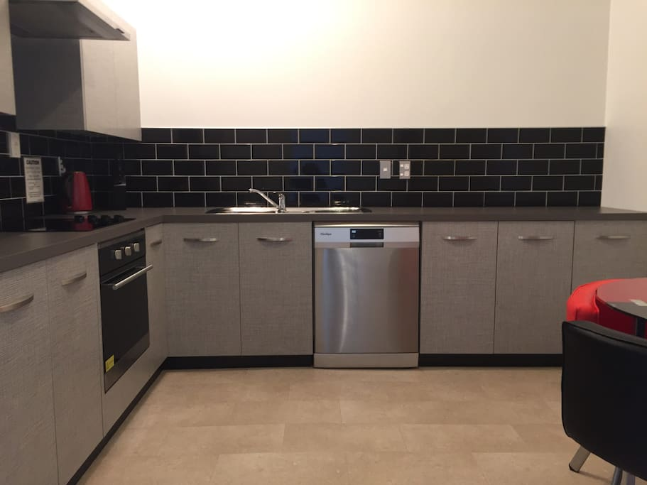 Fully equipt kitchen with dishwasher, oven and cooktop