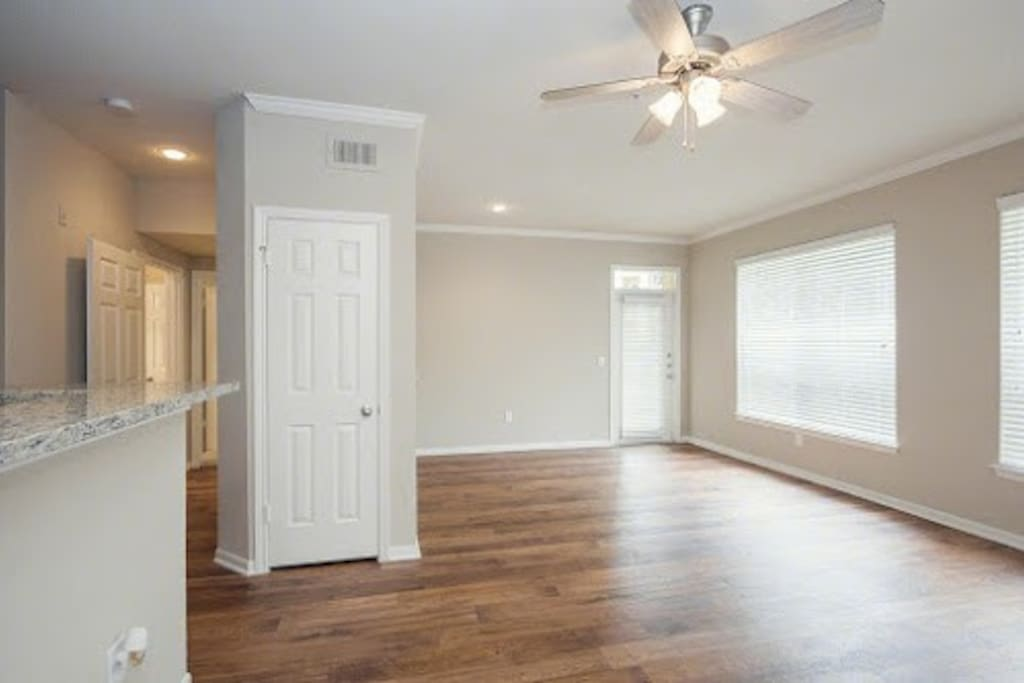 Doors on left lead into the back bedroom that also has tv