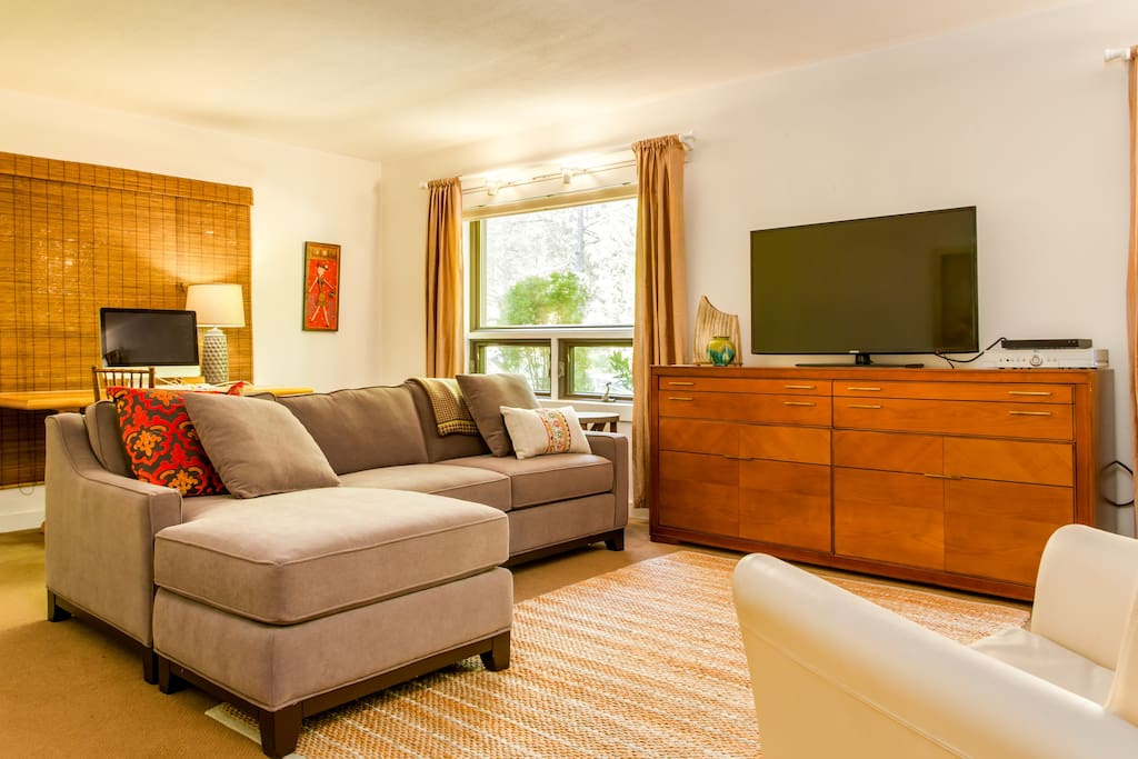 Comfortable furnishings in Living Area on Ground Level looking out at natural area and pond.