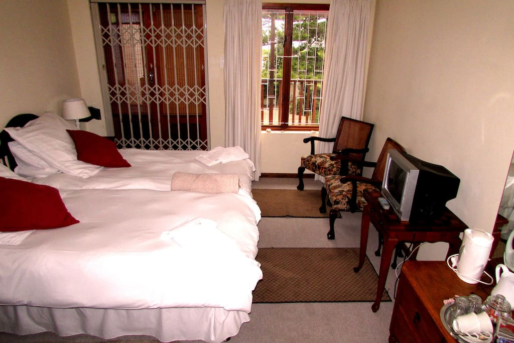 Room 2. Twin beds, en-suite bathroom with shower and a small sharing balcony looking over the driveway.