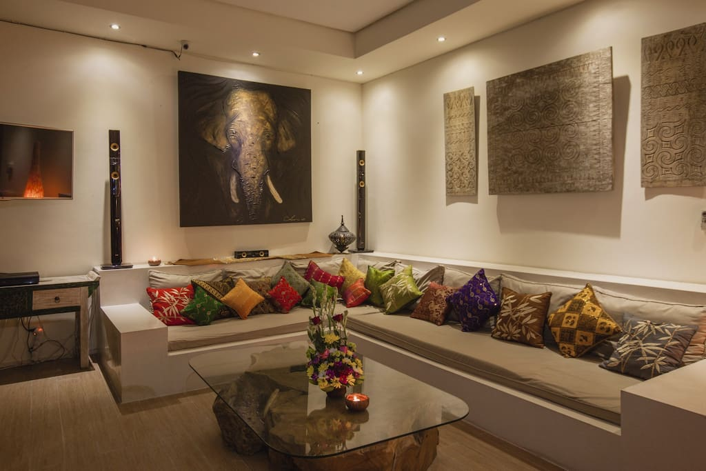 Comfortable lounge zone in living room with good quality sound system - that's what you need to relax with friends