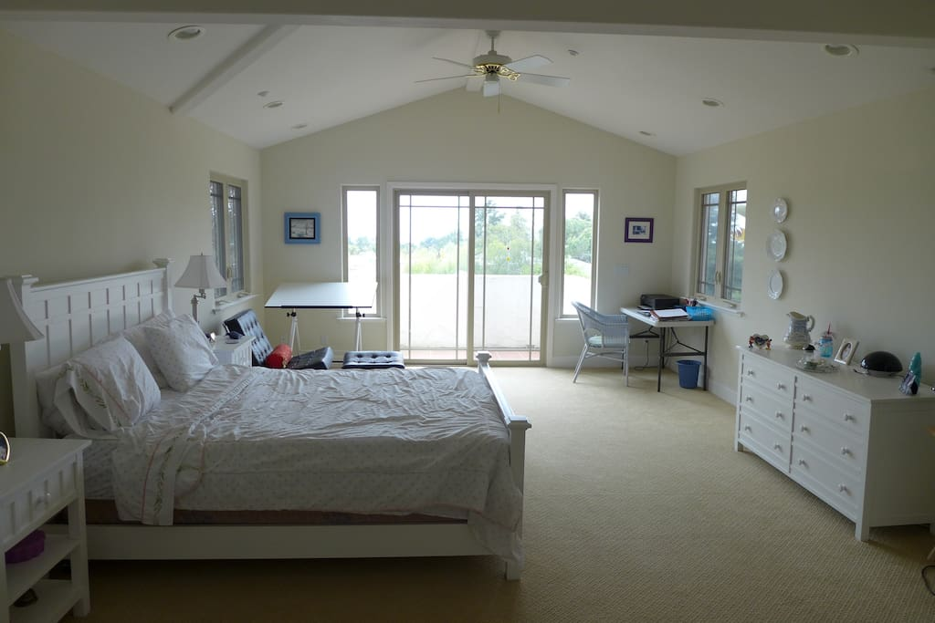 Spacious and light Master Bedroom with walk-in closet and inviting balcony with view of the Monterrey Bay