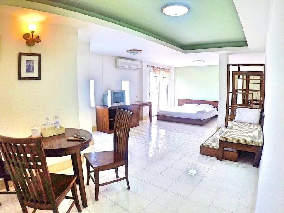 Spacious room with dining table.